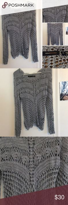 BCBG Maxazria metallic gray crochet sweater This gorgeous BCBG open crochet sweater is in excellent new like condition. It's a beautiful shade of light pearl gray with metallic silver threading.  It is a size small and is 100% Rayon BCBGMaxAzria Sweaters