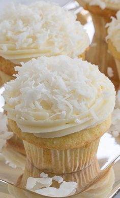 Coconut Cupcakes with Cream Cheese Frosting #cupcakes #cupcakeideas #cupcakerecipes #food #yummy #sweet #delicious #cupcake