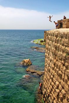 ★♥★ Young boys leap into the Mediterranean  Sea at Caesarea, a coastal town in Israel. Photo provided by  OAT traveler Jason Loeb.  #Israel #Mediterranean