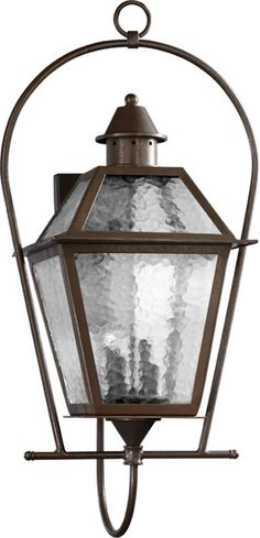 This 4-light Outdoor Lantern by Quorum, is part of the French Quarter Collection. This light would look fantastic adorning the outside of your home or office building. This outdoor wall light has a tr
