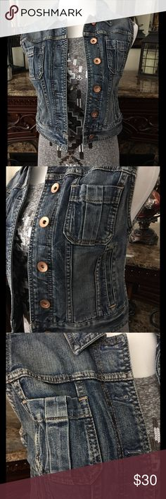 EXPRESS Denim Vest Express Denim vest...medium wash..copper tone buttons...not necessarily cropped but does have a more sleek fit and sits at waist..super cute with everything from dresses to tees...attempted to wear once and changed my mind..has been sitting in my closet ever since. Express Jackets & Coats Vests