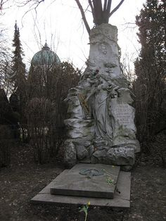 The Grave Of Johann Strauss Johann Strauss's grave was dark, scary and set off to the side of the other composers. He has such a bright, fancy statue in Vienna's Central Park, but here ...