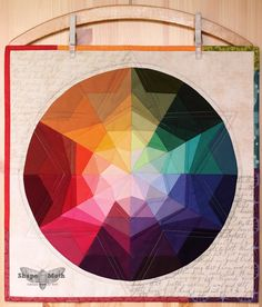 """Lovely """"Prism Star"""" mini quilt by Joanna Wilczynska of Shape Moth. This is an amazing Dresden adaptation."""
