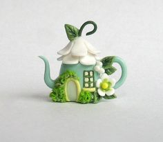 This miniature fairy blossom whimsy house teapot is a one of a kind original design and creation by artist C. Rohal. It is completely hand made,