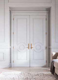 Entrance Ideas: Parisian style double doors with gold hardware and beautiful moulding.