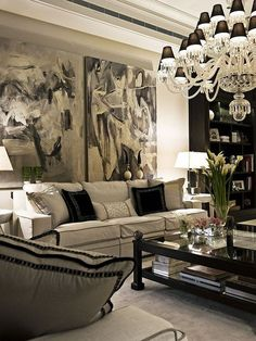 black and white glam living room with chandelier