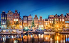 Amazing colorful Amsterdam night. Gotta love the canals and Dutch scenery!