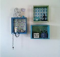 DIY Decoupaged Dorm Shelving with Crates -- Dress up those boring white walls with pops of color.  #decoartprojects