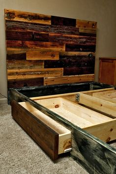 Reclaimed lumber headboard. Really like this! There's even a ton of old wood by the barn! With huge hidden drawers, perfect!