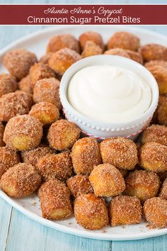 Copycat Auntie Anne's Cinnamon Sugar Pretzel Bites - these taste just like Auntie Anne's but you get this amazing sweet cream cheese dipping sauce with them and they are like eating mini cinnamon roll pretzels!