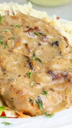 Baked Mushroom Pork Chops ~ The chops are seasoned and then breaded in seasoned crumbs, seared and then baked to perfection under a succulent wine and mushroom thyme sauce. Make sure to serve with mashed potatoes to soak up all that sauce!