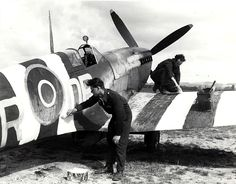 An RAF Supermarine Spitfire receives its D-Day invasion stripes; Tangmere, Sussex, England - 5 June 1944