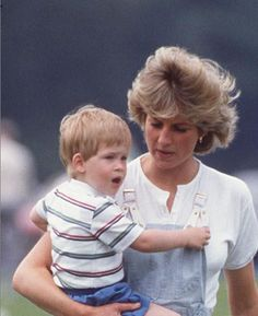 June 28, 1987: Princess Diana with Prince Harry at a polo match at Smith's Lawn, Windsor.