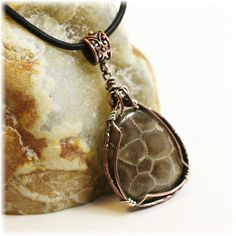 Petoskey Stone / Wrapped in Copper & Sterling with a Patina simplywired4u.etsy.com