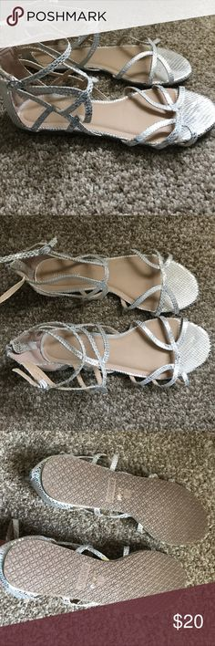 Snake print silver dress sandals Never worn Never worn. Silver snake print sandals with straps then come above the ankles BAMBOO Shoes Sandals
