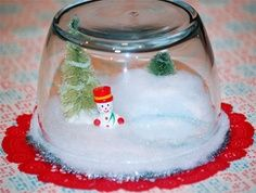 mini trees available at Walmart.  Kids can stretch cotton balls to make snowbed. Use clear plastic Solo cups.  Makes faux snowglobes.