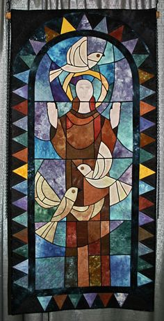 """First Place : 'St. Francis', 27 x 57"""" by Niki Vick. 2010 Austin Area Quilt Guild"""