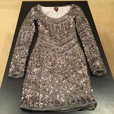 Bebe Sequins NYE dress Color: Grey  Style: Short   Fit: Loose   Condition: Worn only once - fairly new How to Wear: Perfect for NYE or birtnday!   NO trades, NO PayPal, and will consider reasonable offers NOT BM, just for listing❤️❤️ Brandy Melville Dresses Mini