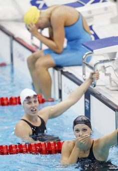 All she does is win     -      Team USA's Dana Vollmer, foreground, learns of her gold-medal win in the 100-meter butterfly swimming final Sunday...my hero!