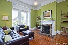 Green Living Room Walls | Green walls, white trim. Love the tile on the fireplace! by marissa