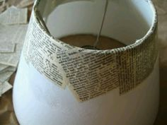BOOK PAGE DIY :: Recover lamp shade with old books. The only thing I'd do differently would be to use whole book pages (vs. cut square pieces) that I ripped out...that way when the light is on you would see the outline of actual torn pages vs. squares of paper. Be aware of the patina of your pages...if you want white or a light patina (cream colored page) or heavy patina (golden pages)…