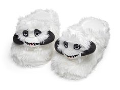 A Pair of White and Fuzzy 'Star Wars' Slippers With a Little Wampa Head on Top of Each
