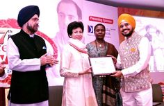 H S Paul of Daily Excelsior receiving award from former Union Minister Kumari Selja MP at a function organized by Pehchan- NGO.