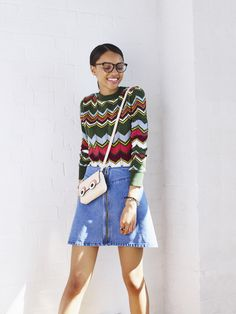 Mixing wavy 70s prints with A-line 60s skirts is a great way to nod to different trends this season. But the thing that ties this look together are the school-girl nuances, like the cross-body bag and glasses.
