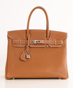 Hermes bag.......I say someday but what I really mean is probably never because I can't guiltlessly buy a $10000 purse