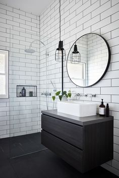 Bathroom White subway tiles are laid horizontally in this smaller bathroom, with the same large format black tiles on the floor. A circular mirror sits above a white basin and black timber vanity, with an industrial-style pendant lamp hangs above. Bathroom Renos, Bathroom Flooring, Bathroom Renovations, Basement Bathroom, Master Bathroom, Bad Inspiration, Bathroom Inspiration, Bathroom Design Small, Bathroom Interior Design