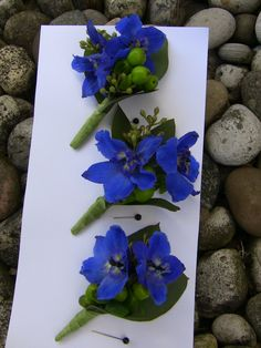 boutineer | Delphinium boutonnieres- add babys breath- take away greens- add silver bow