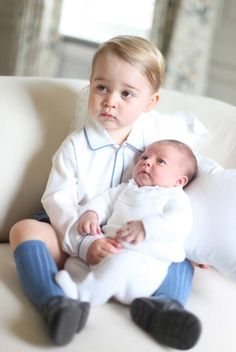 """June 6, 2015 (taken in Mid-May) - Prince George and Princess Charlotte in a photo taken by Kate. """"Kate loves photography so it's not surprising that she took these photos,"""" Victoria Arbiter, royal expert and CNN contributor, tells Yahoo Parenting. """"Although people might be disappointed to not see all four members of the family."""" The timing of the new photos fit tradition, as Kate and William also waited one month to release the first image of Prince George back in 2013."""