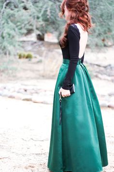 Open back lace trim black top and an emerald maxi, love the black/green combination. WANT