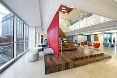 "Zimmerman Advertising | Fort Lauderdale Offices | To embody its belief in the power of ideas and the importance of fostering new and bold ones, the heart of this successful advertising agency's three-story workplace is its ""town square."" An open stair connects reception and executive offices with a third-floor client café. Workspaces are oriented around a ""collaboration ribbon"" comprising open meeting rooms, lounges and support spaces."