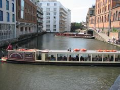 A canal boat turning around in Camden
