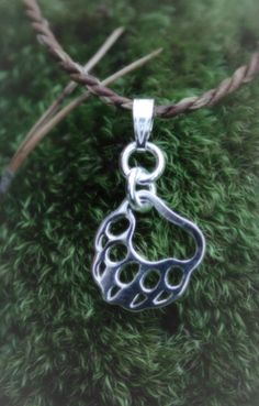 Necklace | Paarma Design       Paw of the bear. The national animal of Finland.    King of the forests is a symbol of good luck and woodlands. National Animal, Finland, Washer Necklace, Flora, Symbols, Forests, Bracelets, Silver, King
