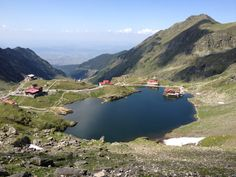 """See 561 photos and 23 tips from 2830 visitors to Lacul Bâlea. """"Wow, it's breathtaking! The crystal clear water, the surrounding mountains, the vibrant. Crystal Clear Water, Romania, Four Square, Places To Travel, Bali, River, Mountains, World, Outdoor"""
