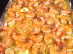 Simple Italian Shrimp: Melt butter in oven on foil lined cookie sheet. Lay lemon slices on melted butter. Lay shrimp on top of butter and lemons. Sprinkle the dry Italian dressing mix on top of shrimp.   Bake at 350 degrees for 15 minutes, until light golden brown.