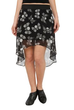 This black skirt features a hi-lo cut overlay with a skull butterfly print. Elastic waistband.