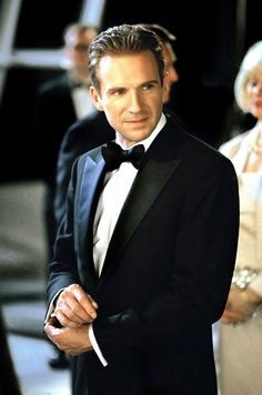 Pin for Later: 19 Sexy Movie Politicians Who Would Win Our Votes Ralph Fiennes, Maid in Manhattan Fiennes sure can rock a suit as senatorial candidate Christopher Marshall, who falls for a hotel maid (Jennifer Lopez) in Maid in Manhattan.