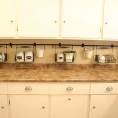 s 17 brilliant ways to declutter every countertop in your home, countertops, home decor, organizing, storage ideas, Keep kitchen countertops clean with baskets