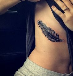 Feather tattoo on the ribs