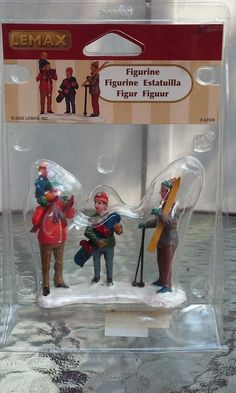 2002 Lemax Figurine Snowboarding and Skiing Back at Base Lodge  #22558