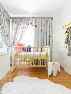 Pops of color and geometric shapes keep this gender-neutral nursery bright and cheerful. @domainehome