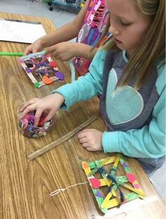 We began these interesting mobile-style hanging sculptures by coloring the sides of our craft sticks with one set of colors on one side, an...