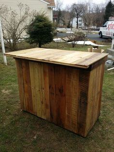 Bar made from Oak pallets. 2 removeable trays.  Left side holds cooler, right side holds trash can and extra beverages.  Bottle opener, sealed with Thompson Water Sealer so ready to be used outside.  See Pappy Repurposers on facebook for additional pictures.