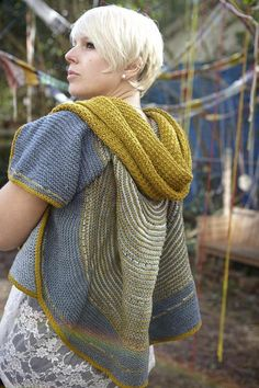"I was knitting a striped shawl and felt lost as I didn't know what to knit next. I found my way by deciding to turn the shawl into a jacket! This garment begins with a semi-circular top down shawl decorated with stripes and short rows. The ribbed back and garter stitch sides grow from picked up stitches. Two front seams mold the fabric into a convertible garment. Wear the garment upside down for even more drama.Finished Measurements: 52"" / 132cm chest circumference. Measurements..."