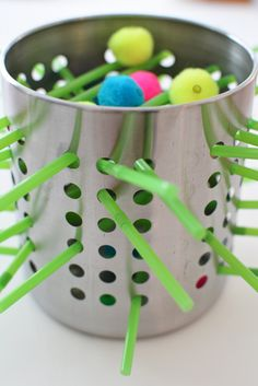 Ever since I saw this wire basket sculpture on Twodaloo, I couldn't get it out of my mind.  Ohhh, the possibilities of this idea! I just love it so much.  I started to notice things with holes and grooves and different ways to use them.  Here is my first inspiration, a homemade Kerplunk game for(...)