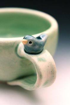Sweet Little Blue Bird on a Pale Green Cup by tashamck on Etsy: Handmade Pottery Bird Cup by Tasha McKelvey: like this to give ideas of somthing students can add to their cup or bowl as ornamental piece.
