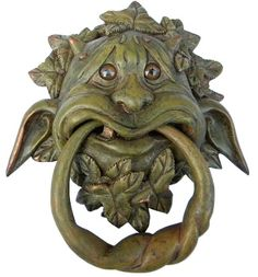 Gargoyle Door Knocker~ I bet I could make something like this out of Femo clay.